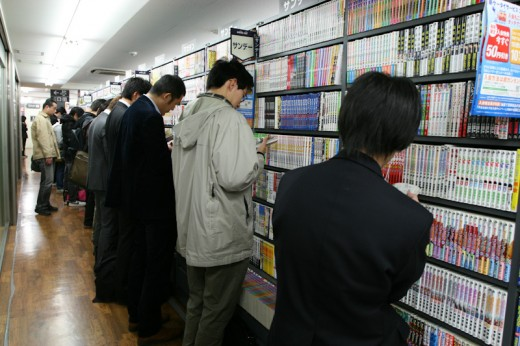 Guys reading Mangas in Book Off Akihabara